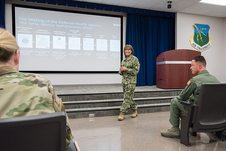Navy Vice Adm. Raquel Bono, Defense Health Agency director, speaks with members of the 42nd Medical Group about upcoming changes to military treatment facilities, at Maxwell Air Force Base, Alabama. The DHA will be responsible for all facilities with respect to budgetary matters, information technology, health care administration and management, administrative policy and procedure and military medical construction. (U.S. Air Force photo by William Birchfield)