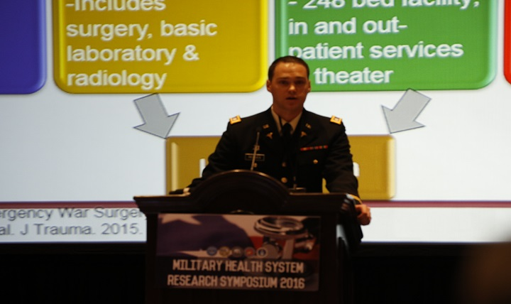 Air Force Capt. David Lindholm, of the San Antonio Military Medical Center, highlights the dangers of mosquito-borne illnesses at the Military Health System Research Symposium in Orlando, Florida