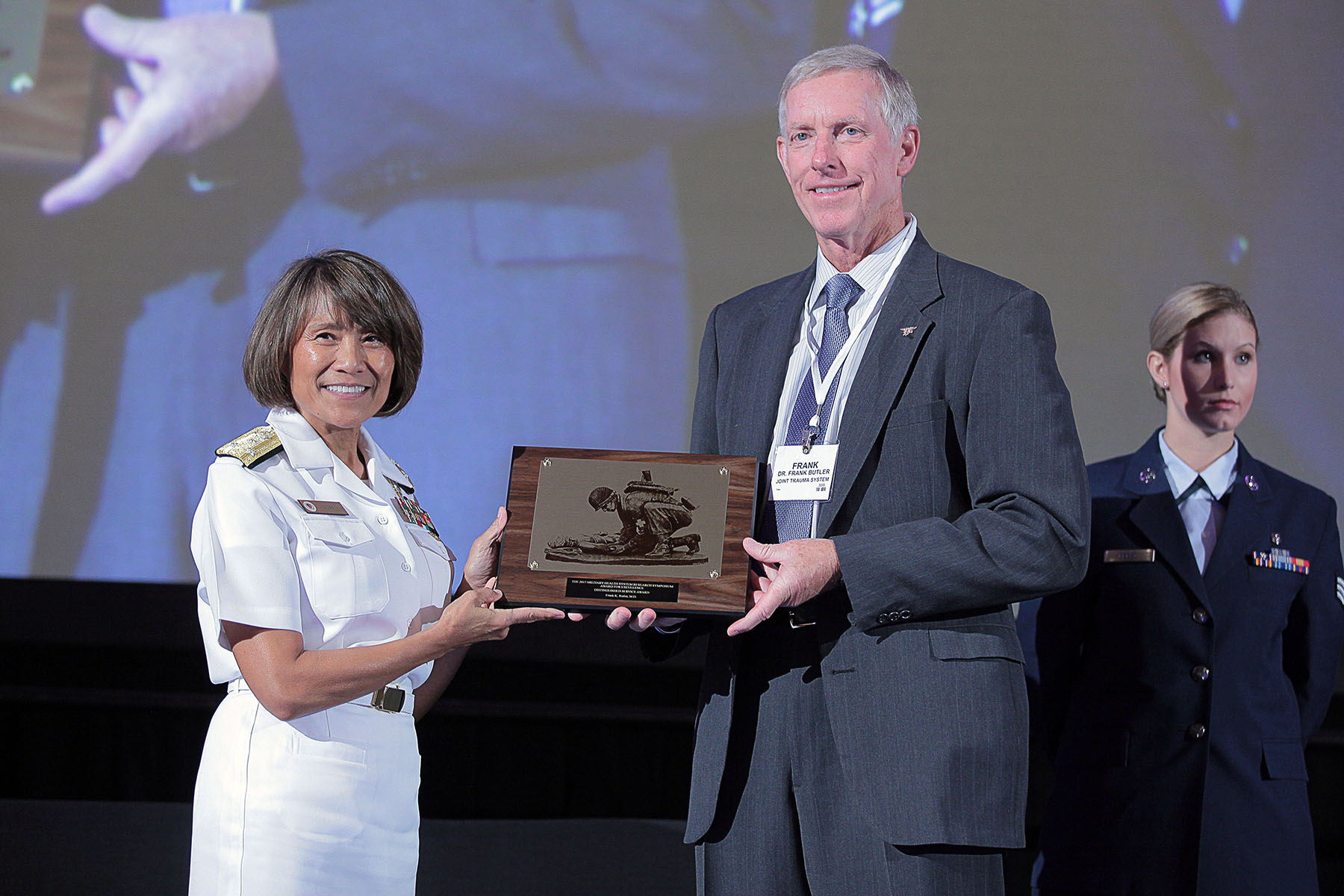 Vice Admiral Raquel C. Bono, director of the Defense Health Agency, presented Frank K. Butler, Jr., M.D. with the 2017 Distinguished Service Award, in the category of Combat Casualty Care, today at the Military Health System (MHS) Research Symposium. The Distinguished Service Award is a lifetime achievement award recognizing an individual who contributed significantly to the success of MHS research and who demonstrates outstanding leadership.