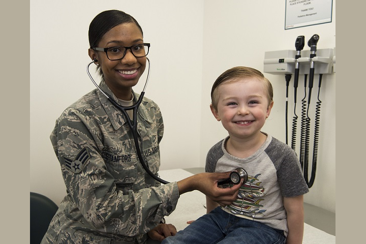 Air Force Senior Airman Shania Stanford, 366th Medical Support Squadron pediatric clinic aerospace medical technician, checks Jude's vitals during an appointment at Mountain Home Air Force Base, Idaho. The pediatric clinic takes care of Airmen and their families by ensuring the overall health of their children. (U.S. Air Force photo by Airman 1st Class Andrew Kobialka)