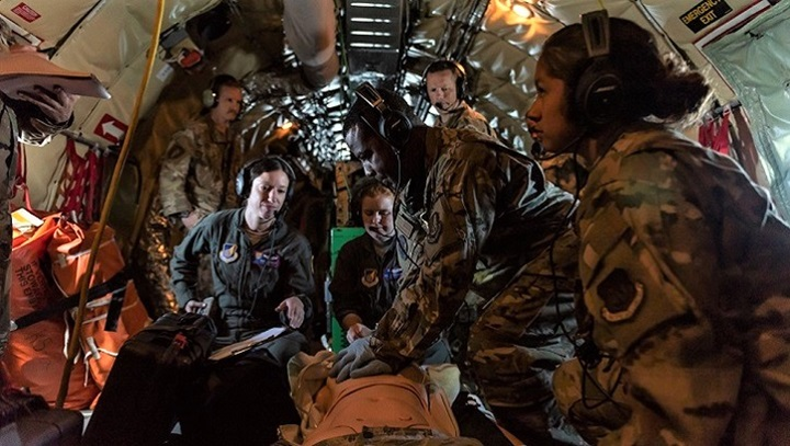Airmen from the 18th Aeromedical Evacuation Squadron simulate life-saving procedures to a training manikin onboard a KC-135 Stratotanker during an exercise out of Kadena Air Base, Japan. The 18th AES maintains a forward operating presence, and was instrumental in saving an Airman's life. (U.S. Air Force photo by Senior Airman Matthew Seefeldt)