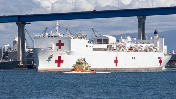 The hospital ship USNS Mercy navigates the San Diego channel March 23. Mercy deployed in support of the nation's COVID-19 response efforts, and will serve as a referral hospital for non-COVID-19 patients currently admitted to shore-based hospitals. This allows shore base hospitals to focus their efforts on COVID-19 cases. One of the Department of Defense's missions is Defense Support of Civil Authorities. DoD is supporting the Federal Emergency Management Agency, the lead federal agency, as well as state, local and public health authorities in helping protect the health and safety of the American people. (U.S. Navy photo by Mass Communication Specialist 3rd Class Lasheba James)