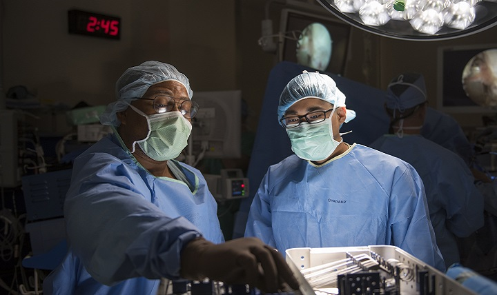 Medical personnel conduct a procedure at the Eisenhower Army Medical Center operating room. Eisenhower AMC was recognized by the American College of Surgeons National Surgical Quality Improvement Program for its surgical safety and quality of care for the second year in a row. (U.S. Army photo by John Corley)