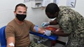 Navy Capt. R. Wade Blizzard, commanding officer of U.S. Navy Support Facility Diego Garcia, donates blood for the Navy Medicine Readiness and Training Units Diego Garcia walking blood bank on Dec. 17, 2020. The walking blood bank is a list of eligible donors who can provide blood in case of emergency. (U.S. Navy photo by Navy Seaman Apprentice Stevin Atkins)