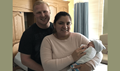 Navy Seaman Joseph White and wife Lauren with their first child, Avalee. Avalee is the first infant born in a military hospital using the Department of Defense's new joint electronic health record, MHS GENESIS. (U.S. Navy photo by Patricia Rose)