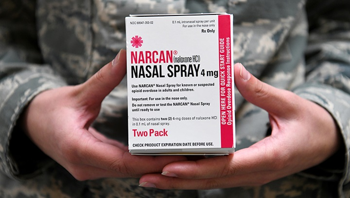 Airman holding Narcan, a brand of naloxone