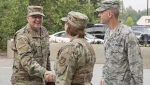 Air Force Chief Master Sgt. Michelle Rootes (center), 673d Medical Group superintendent, and U.S. Air Force Col. Mark Lamey (right), 673d MDG deputy commander, welcome U.S. Air Force Maj. Gen. Lee E. Payne, Defense Health Agency Assistant Director for Combat Support, and Military Health System Electronic Health Record Functional Champion, at Joint Base Elmendorf-Richardson, Alaska, July 9, 2019. Payne visited JBER to discuss upcoming changes to MHS and what that means for patients and providers. (U.S. Air Force photo by Senior Airman Jonathan Valdes Montijo)