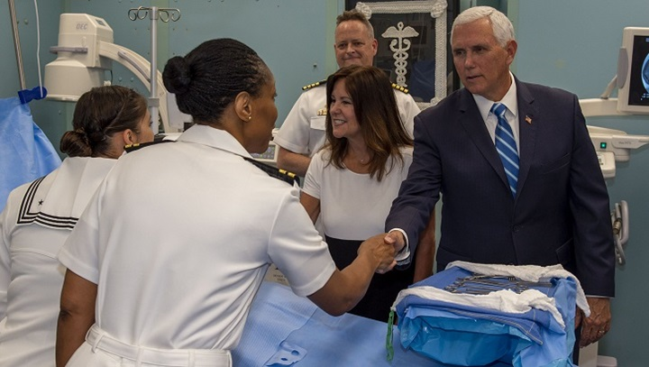 Vice President Mike Pence (right) greets Navy Lt. Gwendolyn Mann, and his wife, Karen Pence (center right), greets Navy Petty Officer 1st Class Edna Wallace during a tour of the USNS Comfort in Miami, June 18, 2019. (U.S. Navy photo by Seaman Jordan R. Bair)