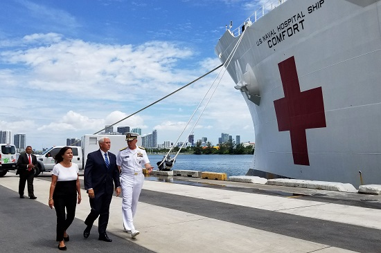 Vice President Mike Pence (center), his wife Karen Pence (left), and Navy Adm. Craig S. Faller, commander of U.S. Southern Command, visit the hospital ship USNS Comfort at the Port of Miami, June 18, 2019. (U.S. Navy photo by Petty Officer Richard L.J. Gourley)