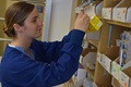Pharmacy technician Hospital Corpsman 3rd Class Shealie Brown fills a prescription order in Naval Hospital Bremerton's Inpatient Pharmacy, part of the command's Pharmacy Department that along with Branch Health Clinics (BHC) Bangor, Everett and Puget Sound Naval Shipyard (PSNS) pharmacies, has been selected for the 2018 Navy Pharmacy Team Award. (U.S. Navy photo by Douglas Stutz)