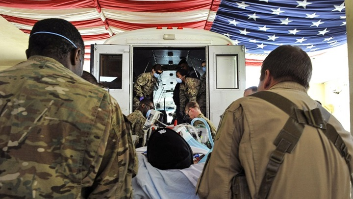Airmen work with members of the Extracorporeal Membrane Oxygenation team to save the life of a NATO troop at the Craig Joint-Theater Hospital on Bagram Airfield, Afghanistan. (U.S. Air Force photo by Tech. Sgt. Nicholas Rau)