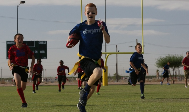 Youth participate in a flag football game on Marine Corps Air Station in Yuma, Arizona. (U.S. Marine Corps photo by Sgt. Travis Gershaneck)