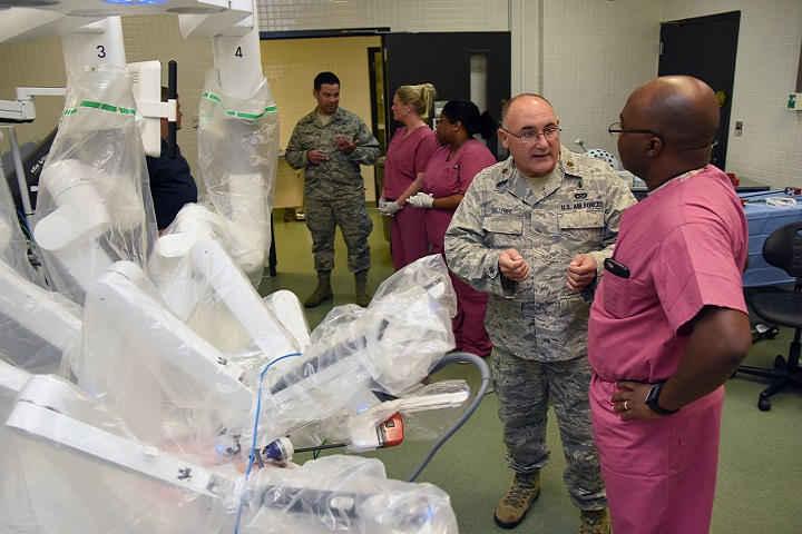 U.S. Air Force Maj. Scott Thallemer (foreground), 81st Surgical Operations Squadron Institute for Defense Robotic Surgical Education program coordinator, Keesler Air Force Base, Miss., and Air Force Maj. Joshua Tyler, InDoRSE program director, provide instruction to students during a robotics surgery training session at Keesler Air Force Base's clinical research lab. (U.S. Air Fore photo by Kemberly Groue)