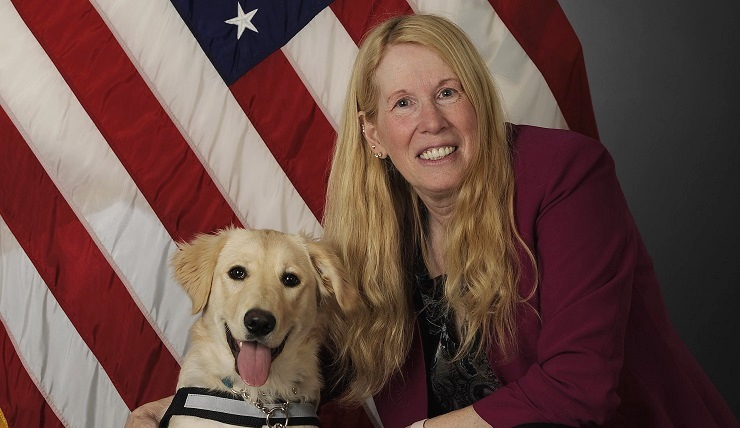 Shellie Severa, the 354th Fighter Wing's sexual assault prevention and response head victim advocate, poses with Tessa, the first SAPR K-9, at Eielson Air Force Base, Alaska. Severa is a certified K-9 trainer. She serves as Tessa's primary handler and has been working as a victim advocate for nine years. (U.S. Air Force photo by Staff Sgt. Ashley Nicole Taylor)