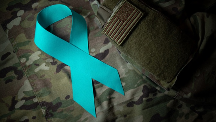 Image of teal ribbon against soldier's uniform