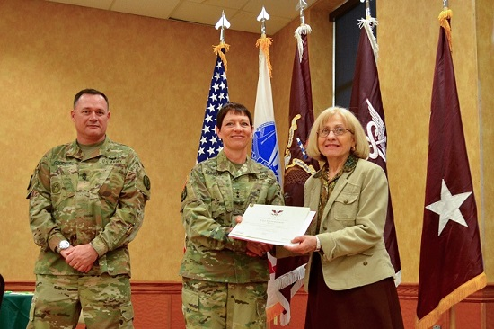 NMHM volunteer docent Sara Handwerker receives the Bronze Presidential Service Award for providing 100 -249 hours of service to the museum in 2017. Each year the Army Volunteer Corps recognizes the dedication and service of volunteers supporting the mission at Fort Detrick and the Forest Glen Annex. (National Museum of Health and Medicine photo by Amanda Quinn)