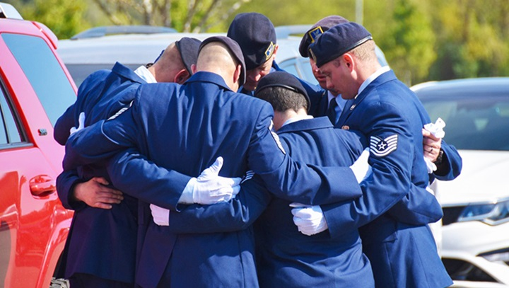 Group of airmen hugging each other