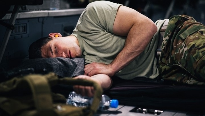 Airman sleeping on floor of plane