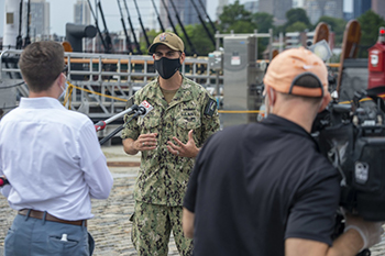 Military personnel being interviewed while wearing a mask