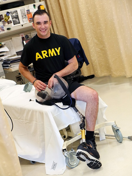 Army Spc. Ezra Maes adjusts his prosthetic leg prior to physical rehabilitation at the Center for the Intrepid, Brooke Army Medical Center's cutting-edge rehabilitation center on Joint Base San Antonio-Fort Sam Houston, Oct. 2, 2019. (U.S. Army photo by Corey Toye)
