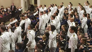 Military medical professionals take their oath at their graduation from the Uniformed Services University of the Health Sciences during a ceremony in Washington, May 18, 2019. More than 200 USU military medical students and graduate nursing students will be graduating early in 2020 to support their colleagues in the U.S. military health system amid the global coronavirus pandemic. (DoD file photo)