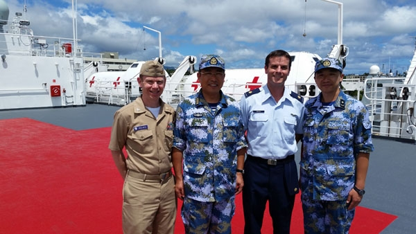 Navy Capt. (Dr.) Jamie Reeves (left) and Air Force Major (Dr.) Geoff Oravec (center, right), of the Uniformed Services University's Center for Global Health Engagement participated in Exercise RIMPAC 2016 with Captain Sun Tao, head of the medical element of the Chinese hospital ship Peace Ark. During the exercise, CGHE delivered its Fundamentals for Global Health Engagement course, which brought together about 30 Chinese Navy medical officers with medical officers from Australia, Canada, and the US Navy.  (Uniformed Services University photo)