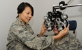 Ophthamologist Air Force Maj. Thuy Tran evaluates a patient during an eye exam. (U.S. Air Force photo by Tech. Sgt. John Hughel)