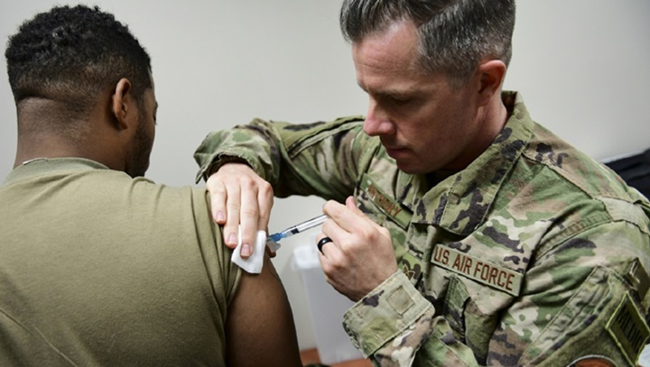 Tech Sgt. Joseph Anthony, medical technician with the 911th Aeromedical Staging Squadron, administers a vaccination to a member of the U.S. Army Reserve's 336 Engineering Company Command and Control, Chemical Radiological and Nuclear Response Enterprise Team at the Pittsburgh International Airport Air Reserve Station, Pennsylvania, April 11, 2019. Department of Defense-issued vaccinations are used to prevent a variety of diseases that military members may encounter in the course of their duties. (U.S. Air Force photo by Joshua J. Seybert)