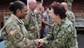 Navy Rear Adm. Mary Riggs greets Army Maj. Angela Hinkson