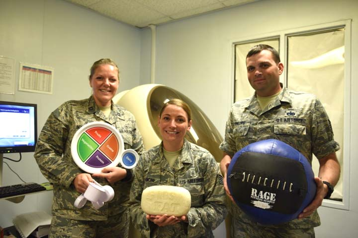 From left, Air Force Capt. Abigail Schutz, 39th Medical Operations Squadron health promotions element chief, Staff Sgt. Jennifer Mancini, 39th MDOS health promotions technician, and Tech. Sgt. Brian Phillips, 39th MDOS health promotions flight NCO in charge, pose for a photo at Incirlik Air Base, Turkey. Learning about proper nutrition can help service members stay healthy and ensure they're in optimal warfighting shape. (U.S. Air Force photo by Staff Sgt. Matthew Wisher)