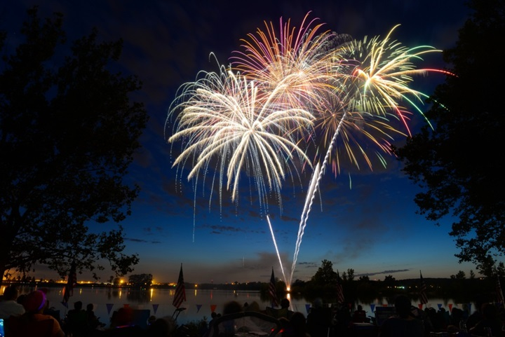 Fireworks fill the sky on July 8, 2017 at Offutt's base lake during the annual fireworks display. Several family activities took place at the celebration including face painting, a treasure hunt and a performance from the Heartland of America Band. (U.S. Air Force photo by Zachary Hada)