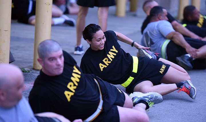 Army Reserve Sgt. Mindy Baptist (center), stretches out after morning battalion physical training exercise. Not every workout needs to top out the intensity scale. In fact, doing too much too often can lead to overtraining and injury. Remember to listen to your body and incorporate rest or light days into your workout regimen. (U.S. Army photo by Sgt. Aaron Berogan)