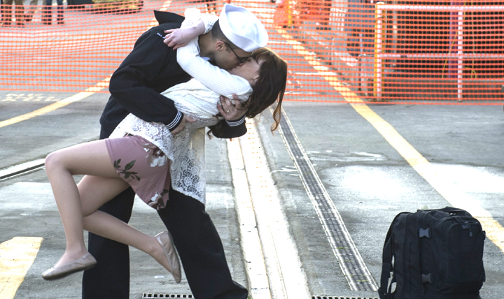 "Mononucleosis is nicknamed the ""kissing disease"" because it's spread through saliva. U.S. Navy Logistics Specialist 3rd Class Michael Zegarra shares the traditional first kiss with his wife Caterina Zegarra, after the aircraft carrier USS Nimitz pulled into port at Naval Base Kitsap, Washington, Dec. 10, 2017. (U.S. Navy photo by Seaman Greg Hall)"