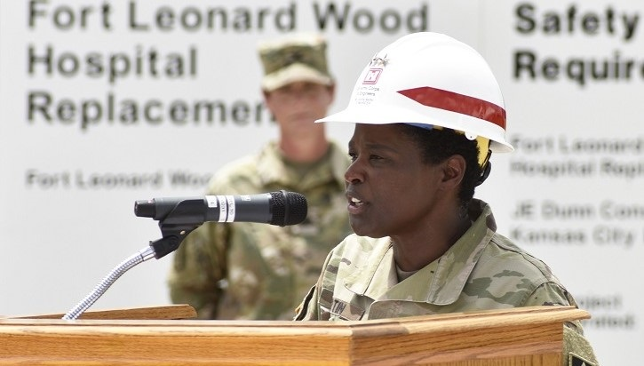 Soldier in hardhat at podium