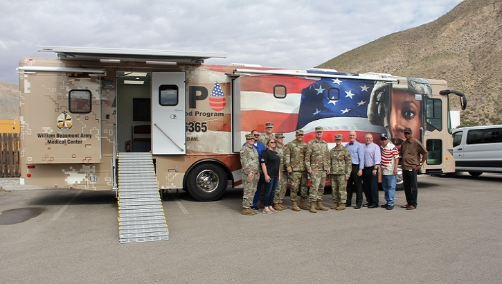 Leadership from William Beaumont Army Medical Center, the Fort Bliss Armed Services Blood Program Blood Donor Center, and the El Paso Veteran's Affairs Health Care System pose for a picture in front of the new blood-mobile that arrived July 2, 2019, at WBAMC. (U.S. Army photo by Amabilia Payen)