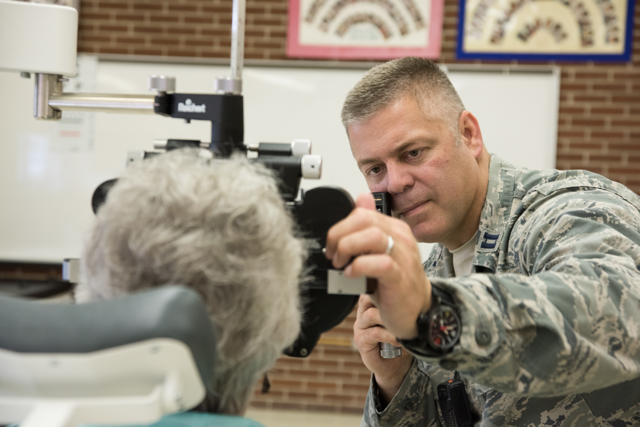 U.S. Air Force Capt. Brett Ringger, optometrist , 136th Medical Group, Texas Air National Guard, examines a patient  during the Greater Chenango Cares Innovative Readiness Training in Cortland, New York. The IRT provided medical care to patients at no cost, as well as eye examinations and glasses on site. (U.S. Air Force photo by Senior Master Sgt. Elizabeth Gilbert)