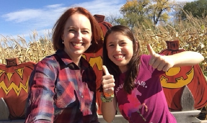 Air Force Col. Theresa Medina, 319th Medical Group commander, and her daughter Sophia, pose for a photo at a harvest festival Oct. 7, 2017 at Grand Forks, N.D. Medina was diagnosed with stage one breast cancer on Nov. 3, 2011, but with the help of TRICARE and the support of family and friends she is now cancer free. (Courtesy photo)