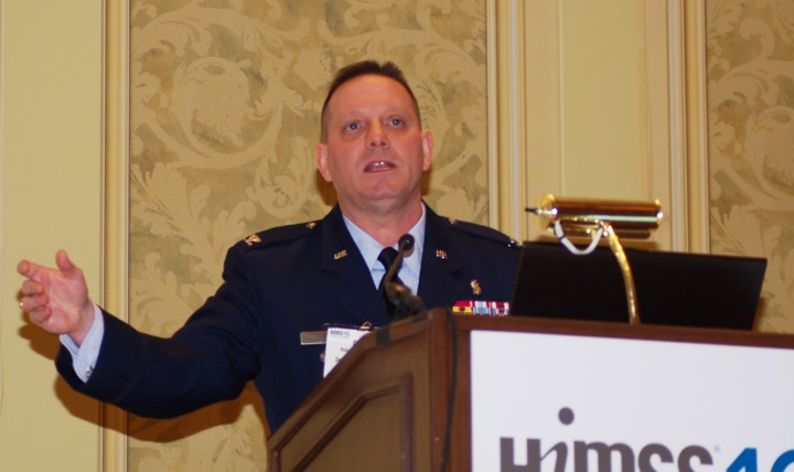 "Air Force Col. Richard ""Chip"" Terry, acting director of the Health Information Technology Directorate at DHA, speaks at HIMSS about a major transformation underway within MHS to modernize health data and technology management."