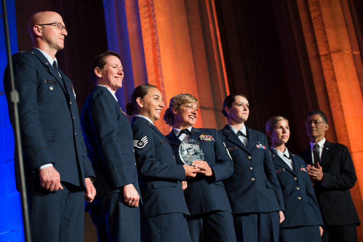 The 99th Medical Group, Nellis Air Force Base, Nevada receives the 2018 Heroes of Military Medicine Ambassador Award in Washington, D.C., May 3, 2018, for the life-saving efforts of three of its airmen during the tragic Las Vegas shooting on Oct. 1, 2017. Army Maj. Gen. (retired) Joseph Caravalho (right), president, Henry M. Jackson Foundation for the Advancement of Military Medicine presented the award to the 99th MG. (MHS photo)