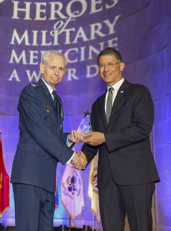 Air Force Col. William E. Nelson, chief, integrated and international operational medicine, 711th Human Performance Wing, is presented a 2018 Heroes of Military Medicine Award in Washington, D.C., May 3, 2018, by Air Force Maj. Gen. (retired) Joseph Caravalho, president, Henry M. Jackson Foundation for the Advancement of Military Medicine. Colonel Nelson was recognized for his exemplary career as an Air Force flight surgeon and for his contributions to the Air Force Integrated Operational Support mission. (Courtesy photo by the Henry M. Jackson Foundation for the Advancement of Military Medicine)