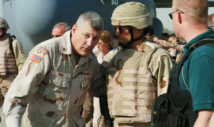 Then-Brig. Gen. Carter Ham (left) talks with the Army vice chief of staff, Gen. George Casey, after senior military leaders arrive in Mosul, Iraq, in June 2004.  (Courtesy photo)