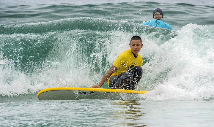 Marine Corps Cpl. Leighton Anderson surfs a closed out wave during the Naval Medical Center San Diego surf therapy clinic in Del Mar, California. Participation in the therapy clinic for patients like Leighton is medically appointed, and its many benefits include pain management and post-traumatic stress disorder treatment. (DoD photo by EJ Hersom)