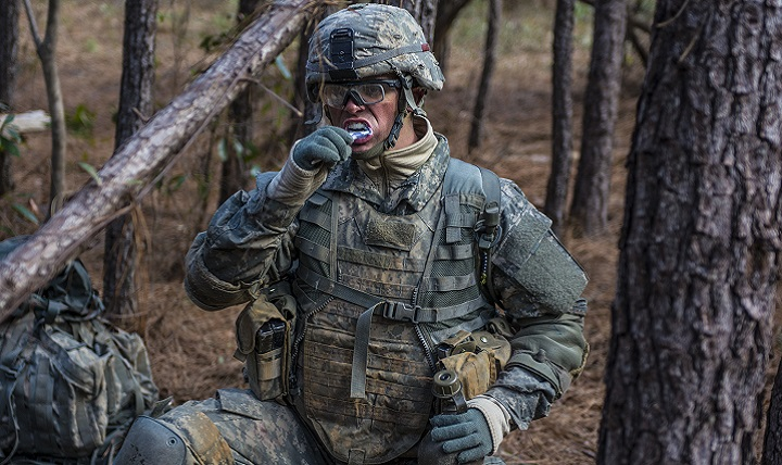 A Soldier with C Company, 1st Battalion, 61st Infantry Regiment brushes his teeth on a cold morning at the Victory Forge field training exercise on Fort Jackson, South Carolina. (U.S. Army photo by Sgt. 1st Class Brian Hamilton)